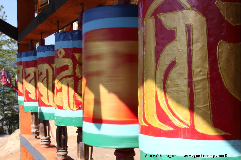 Small temple on the way with beautiful prayer wheels