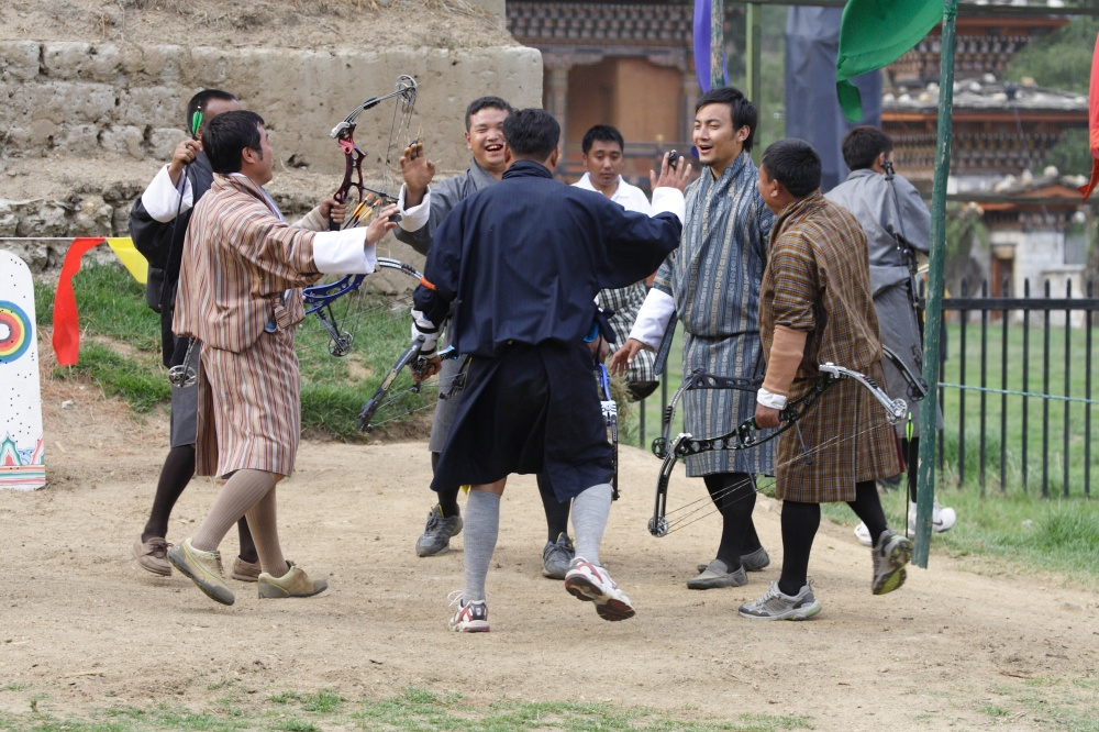 Archery-Bhutan - Archers celebrate after a good shot