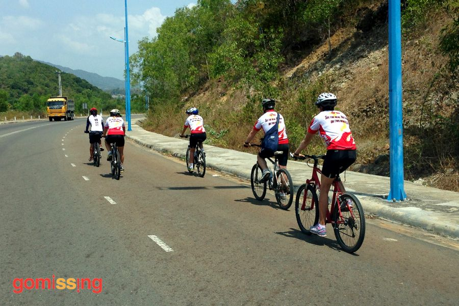 Cruising along the highway - Vietnam cycling