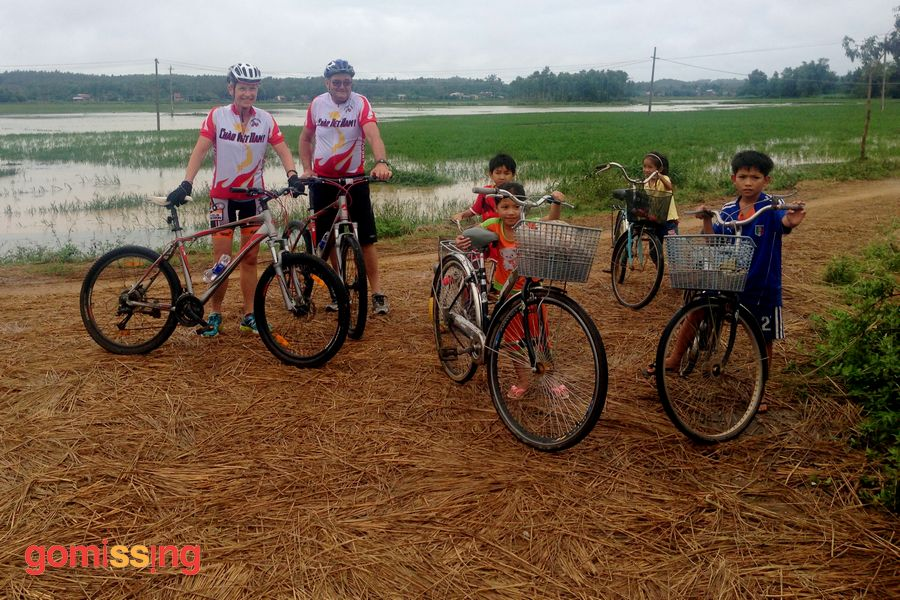 With village kids - Vietnam Cycling tour