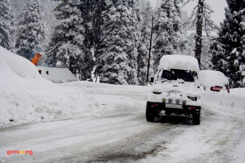 Car covered in snow Gulmarg, Kashmir